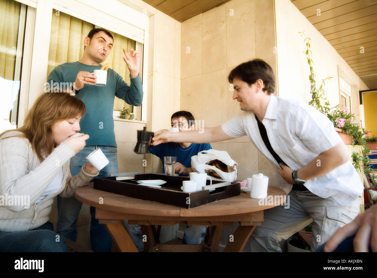 Group of friends having breakfast together Stock Photo
