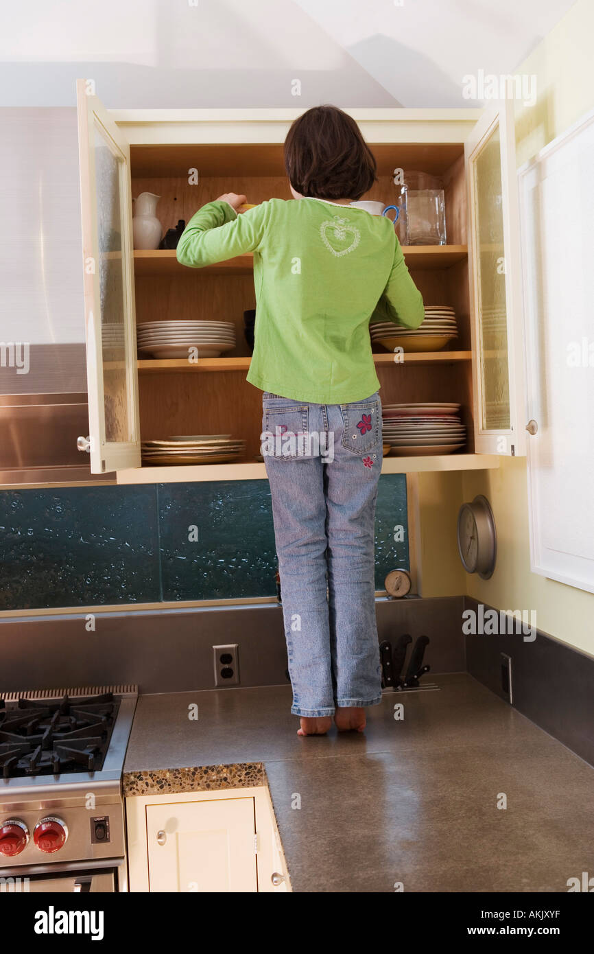Reaching Into Cupboard Stock Photos Amp Reaching Into