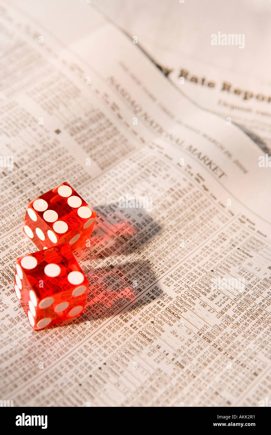 Close up of dice on stock market paper - Stock Image
