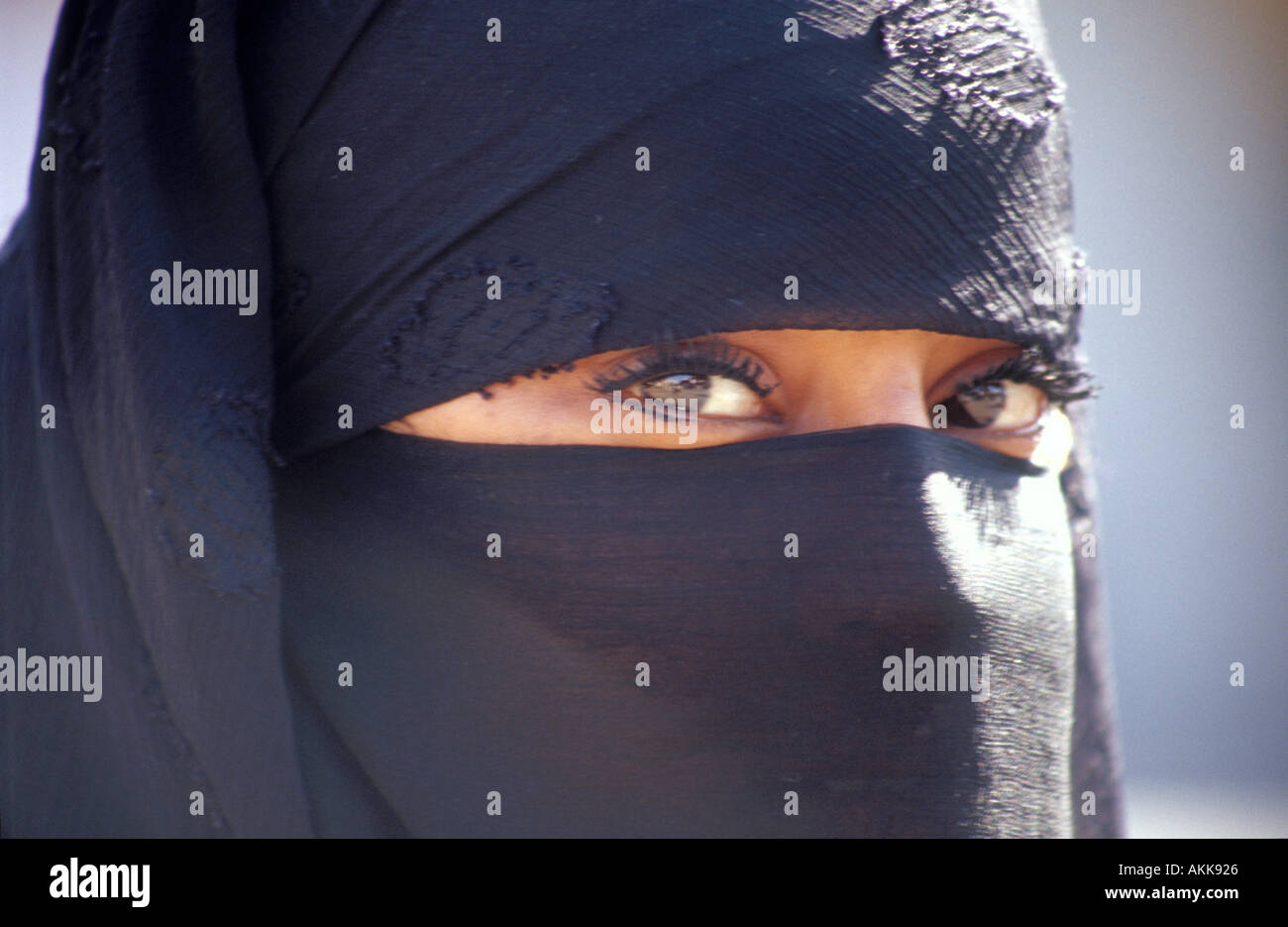 Close up horizontal portrait of berber lady in veil Marrakech Morocco North Africa - Stock Image