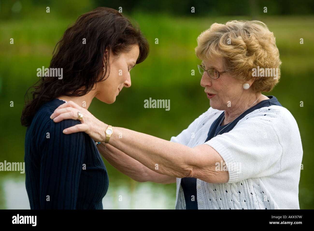 Senior woman consoling her daughter - Stock Image