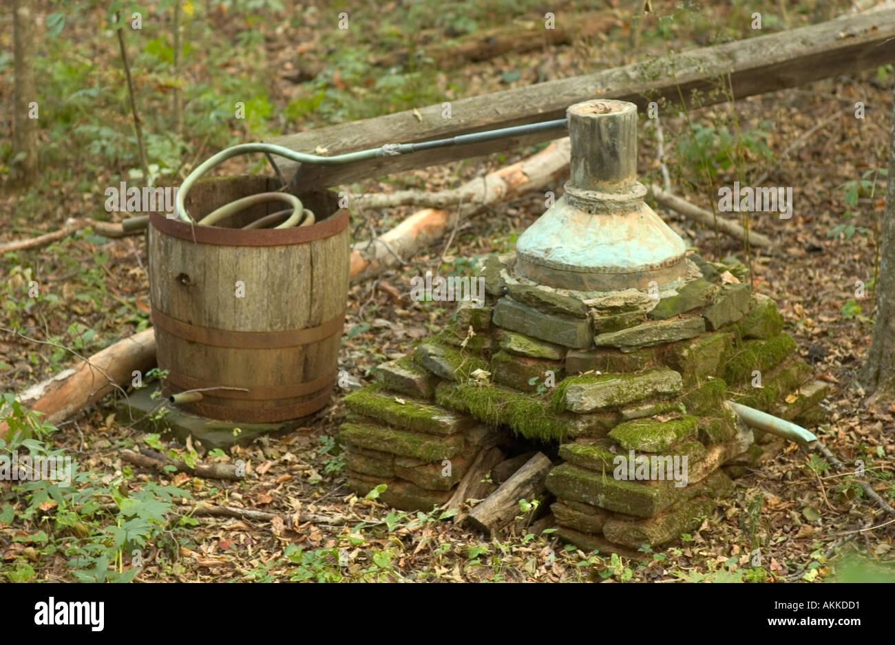 Old moonshine whiskey stihl on display at Mabry Mill on the Blue Ridge Parkway VA USA - Stock Image