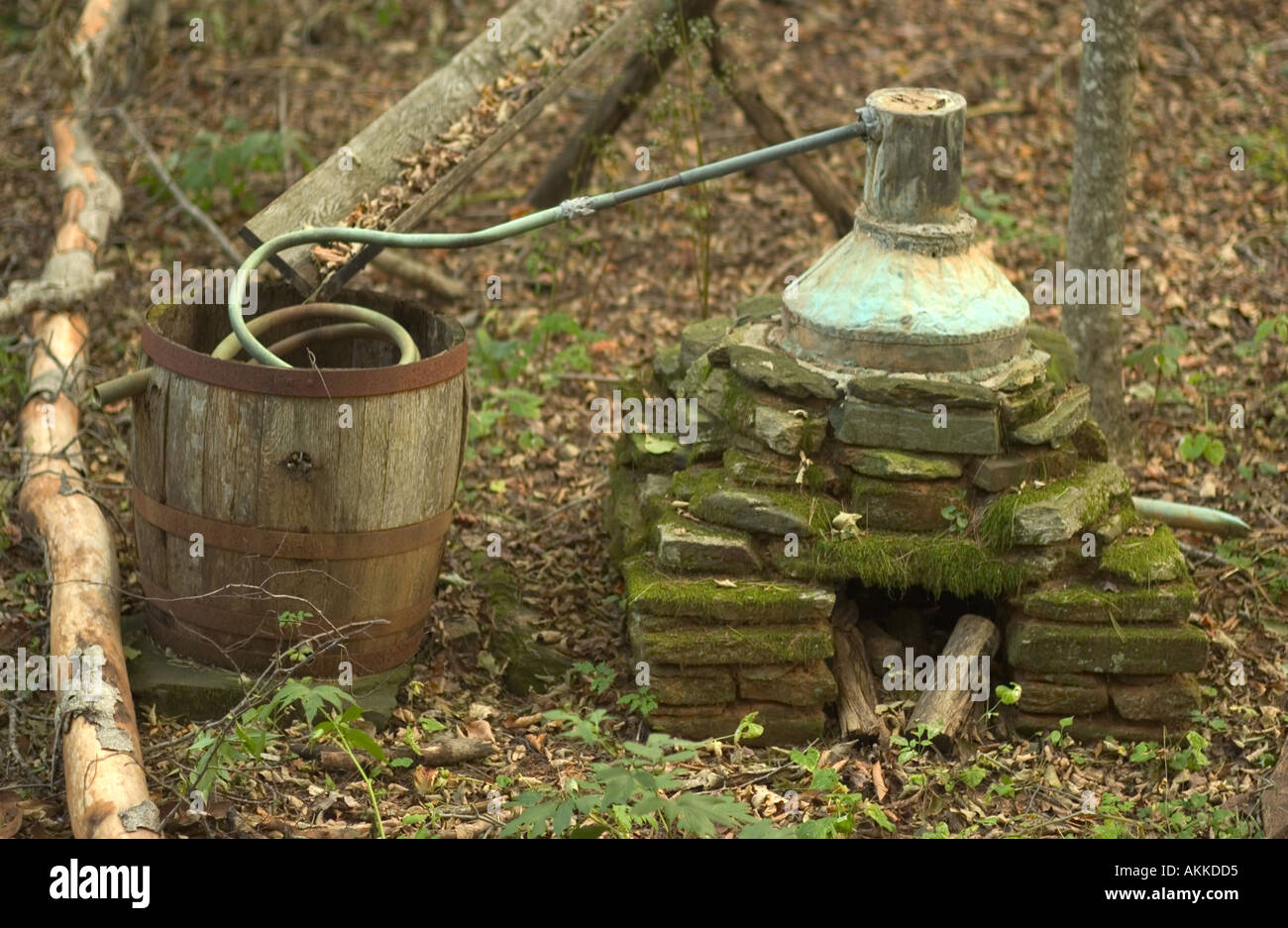 Old moonshine whiskey stihl on display at Mabry Mill on the Blue Ridge Parkway VA USA - Stock Image