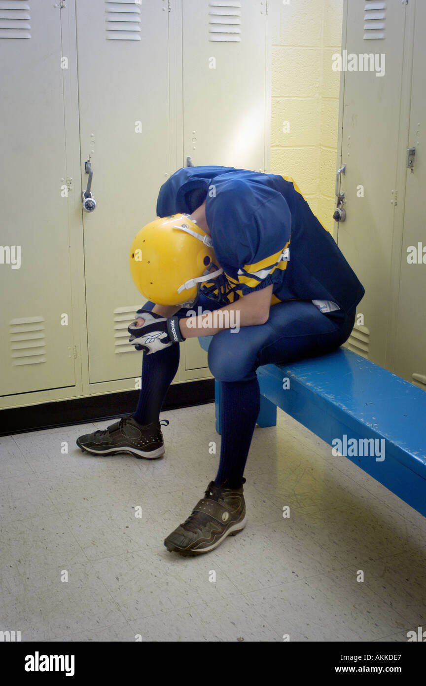Depressed after loss High School Football action Port Huron Michigan Stock Photo