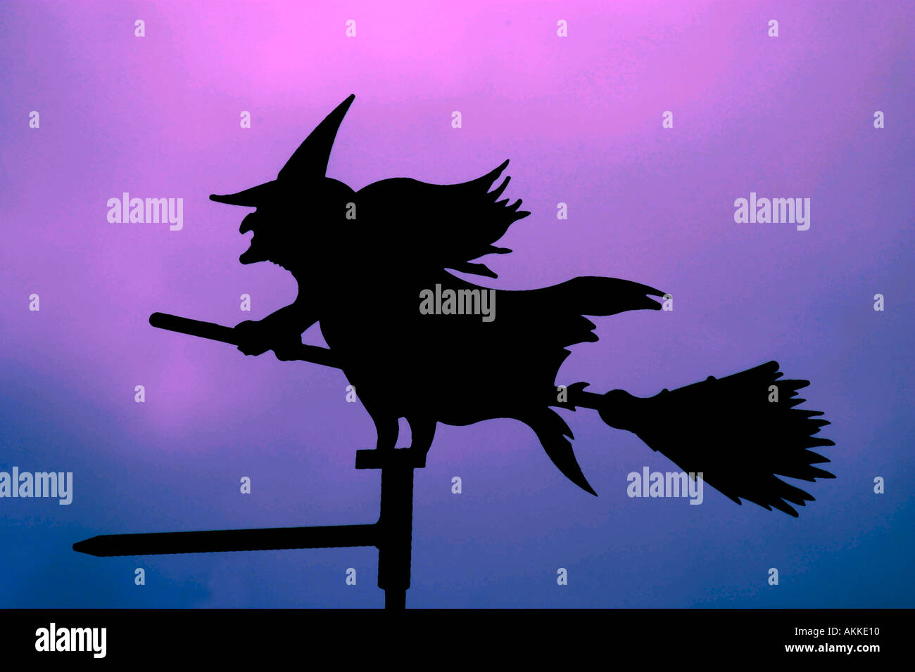 Witch weather vain on broom - Stock Image