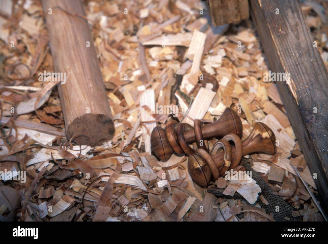 Mike Abbott a coppice craftsman a baby rattle his made on his pole lathe - Stock Image