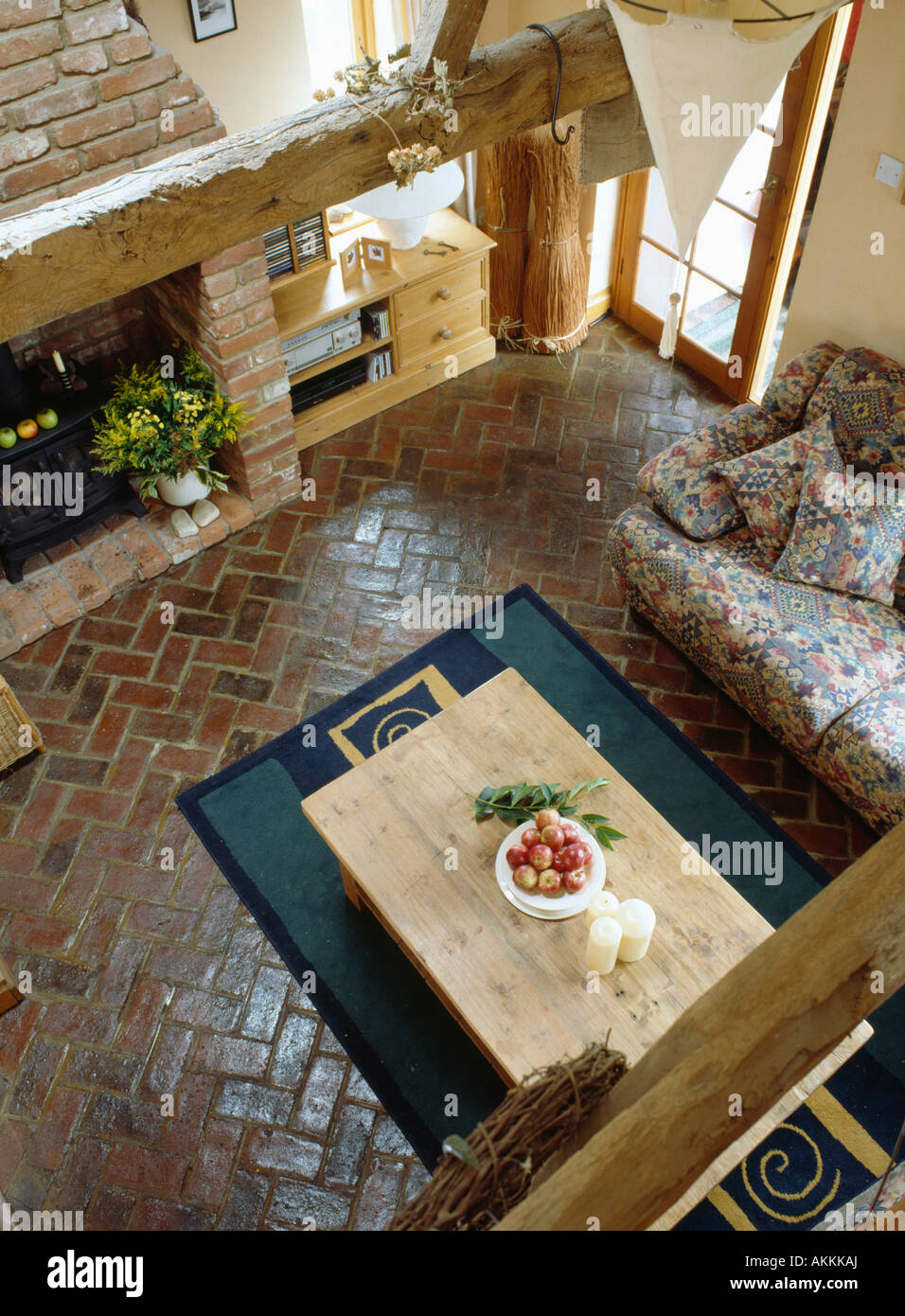 Aerial View Of Pine Table On Herringbone Pattern Reclaimed Brick Floor In Country Living Room