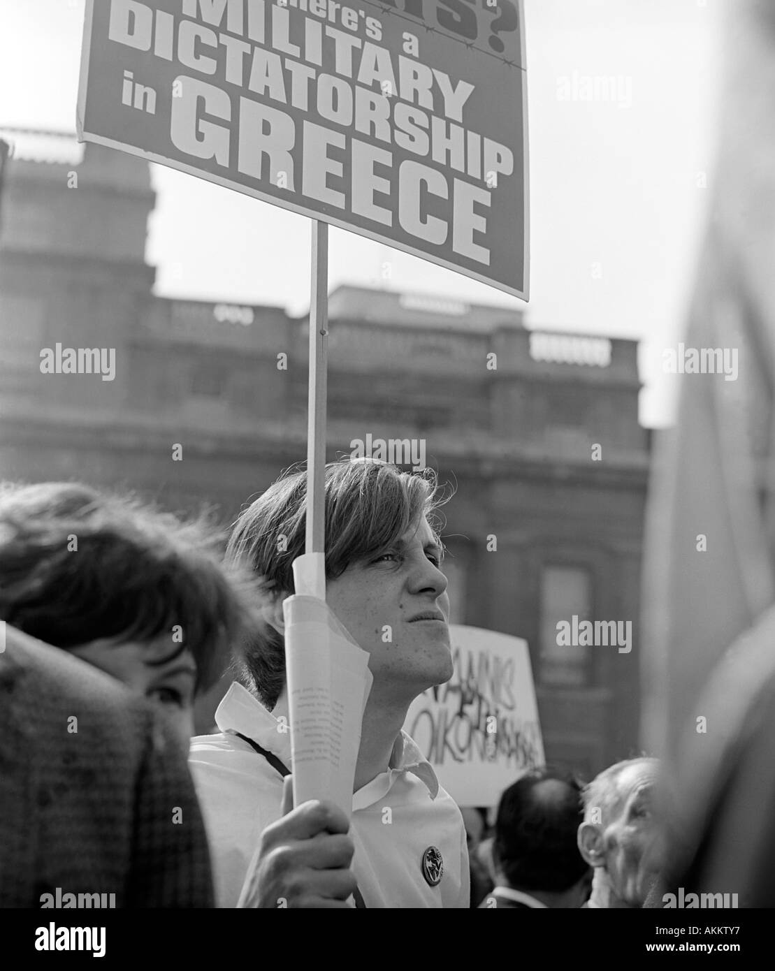 A protester at a 1968 demonstration in Trafalgar Square, London against the military regime in Greece. Stock Photo