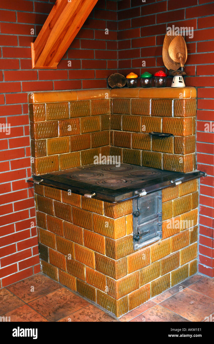 Old tiled stove - Stock Image