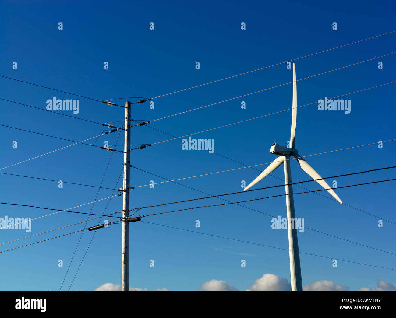 Canada Quebec Gaspesie Cap Chat wind turbine used to generate electricty and hydro power lines Stock Photo