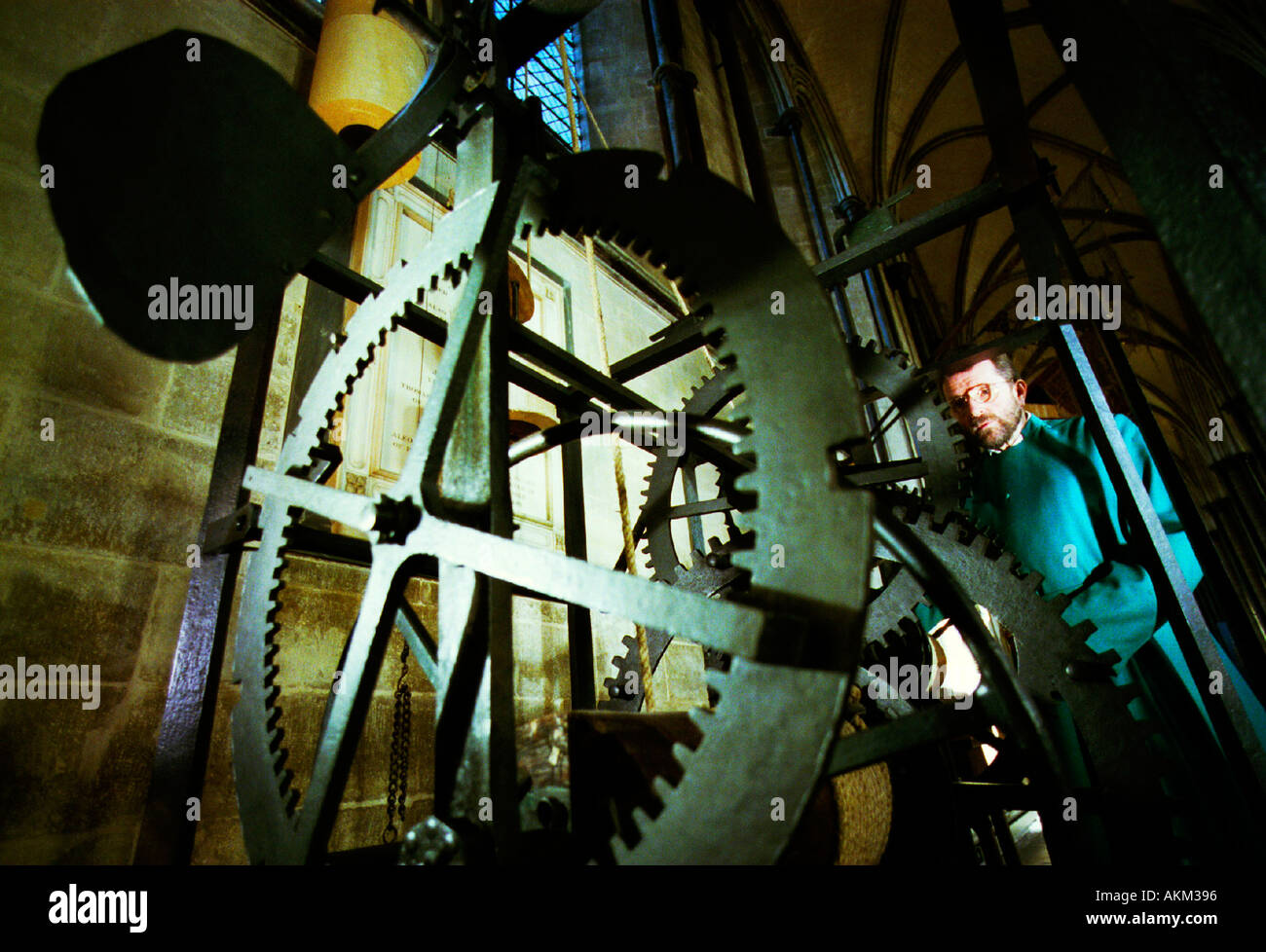 Verger Peter Wheatcroft adjusts Englands oldest working clock  built before 1386 and kept in Salisbury Cathedral - Stock Image