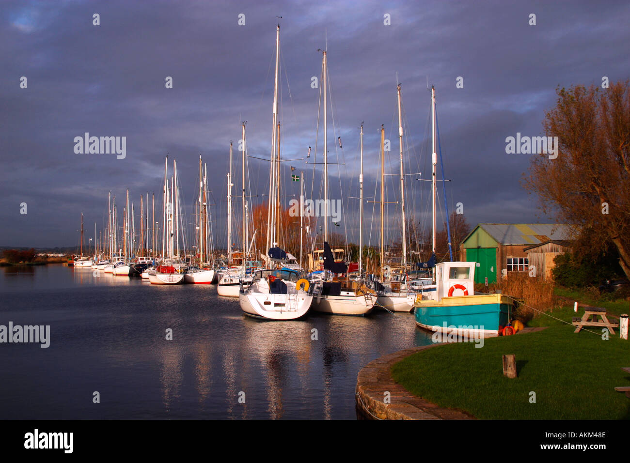 Exeter Canal near Turf Locks with sailing boats and reflections on the water in winter sun Exe estuary near Exmouth Exeter Devon - Stock Image
