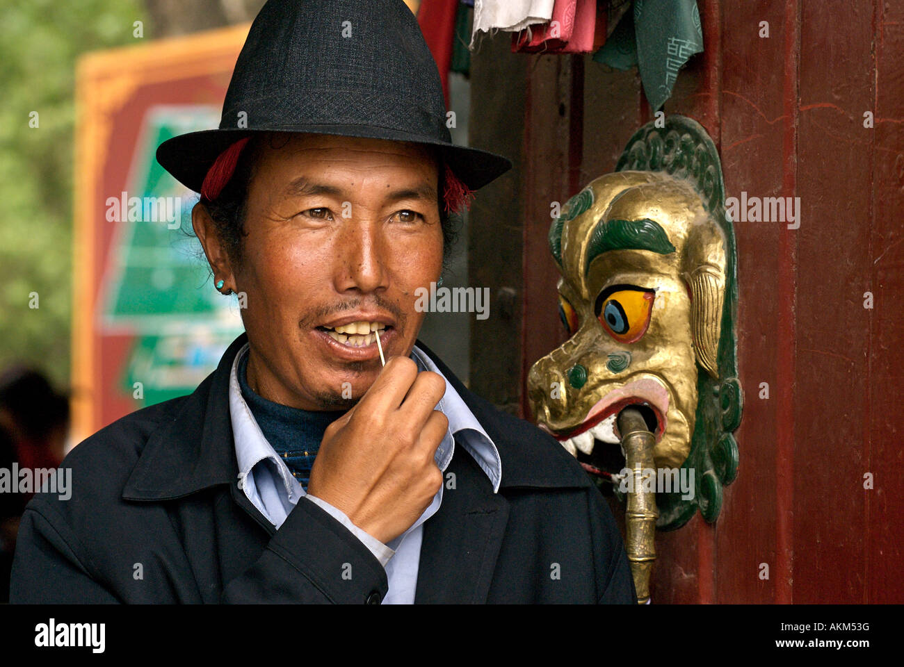 Tibetan man using a toothpick at the entrance to the Summer Palace TibetStock Photo