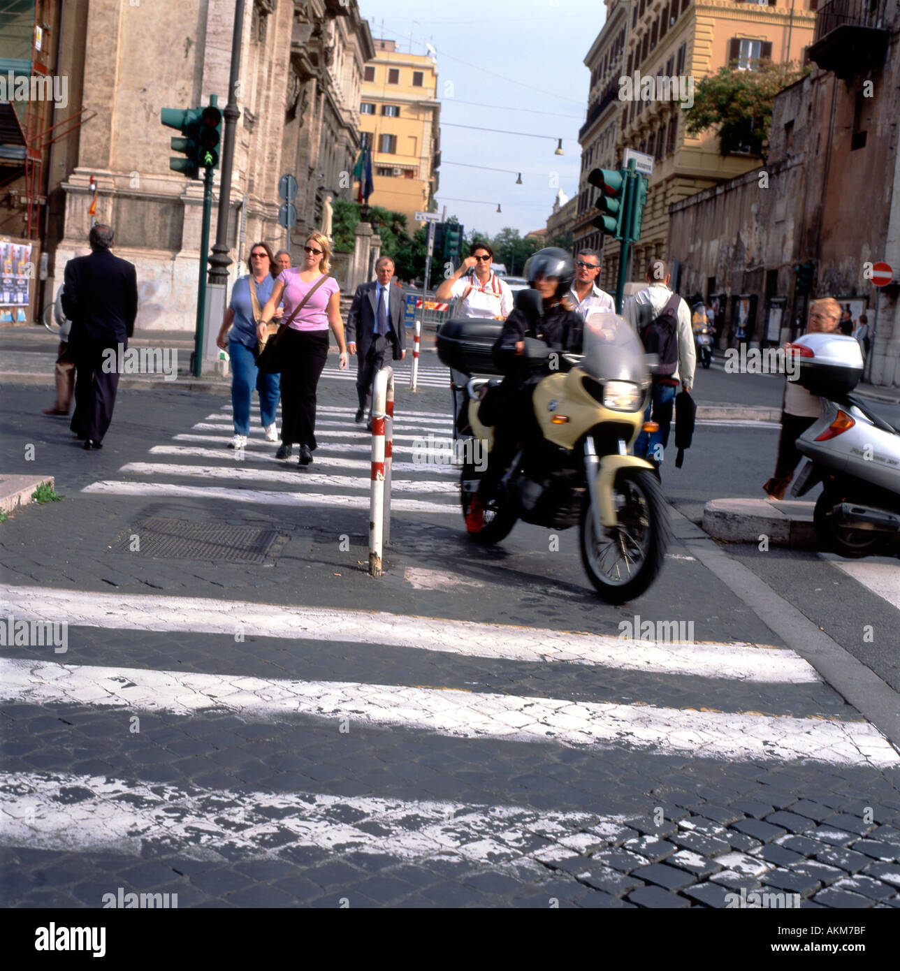 A motorcycle driving on a pedestrian zebra crossing in Rome, Italy   KATHY DEWITT Stock Photo