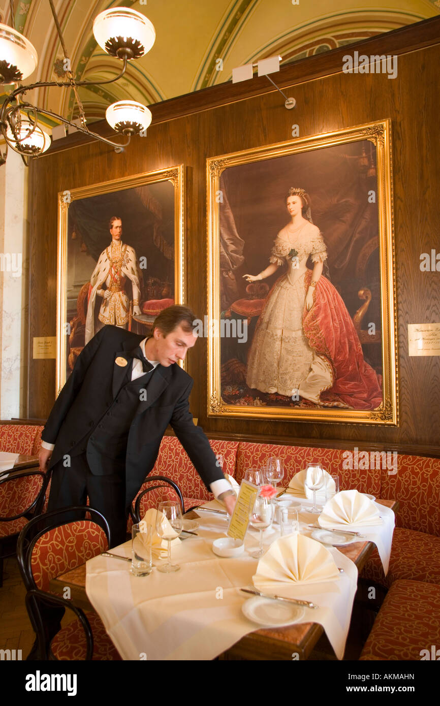 Waiter checking table in Cafe Central Vienna Austria Stock Photo
