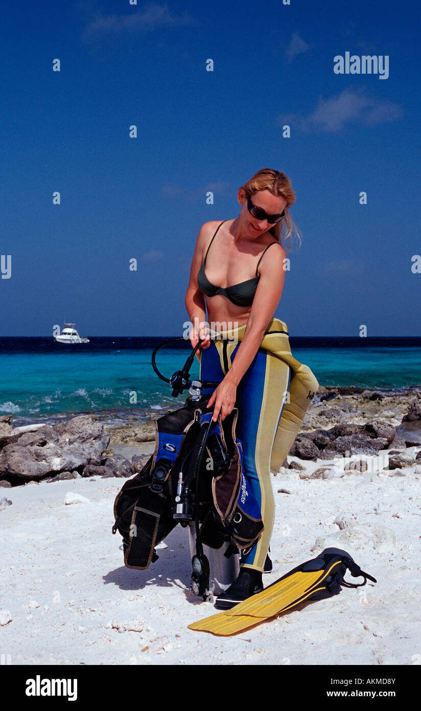 Woman Preparing To Dive On The Beach Netherlands Antilles