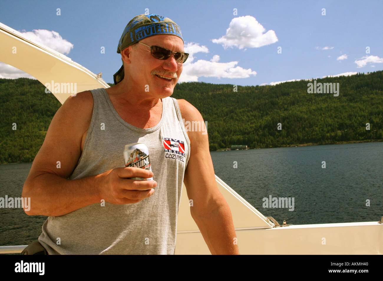 Play Hard drining beer  on a holiday boat cruise - Stock Image