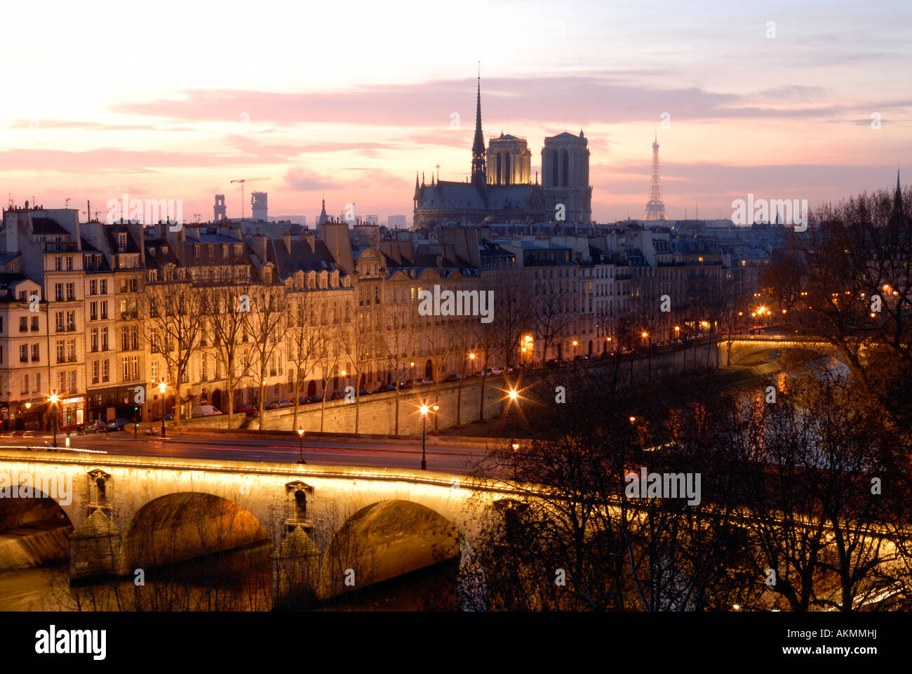 France, Paris, Pont Marie above Seine river, Ile Saint Louis, Notre Dame cathedral and the Eiffel Tower in the background - Stock Image