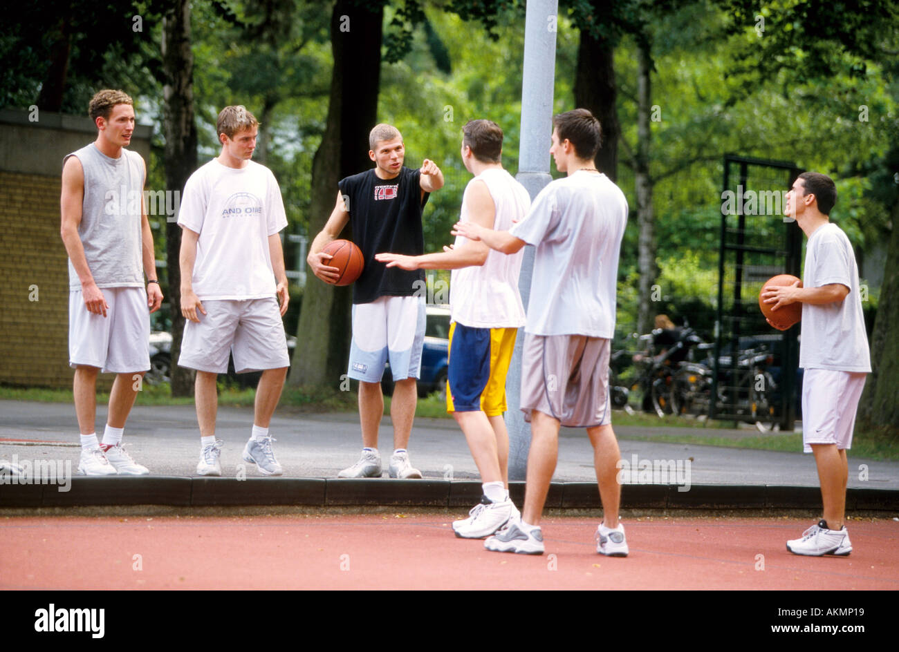 Germany Free time Young men playing basketball  - Stock Image