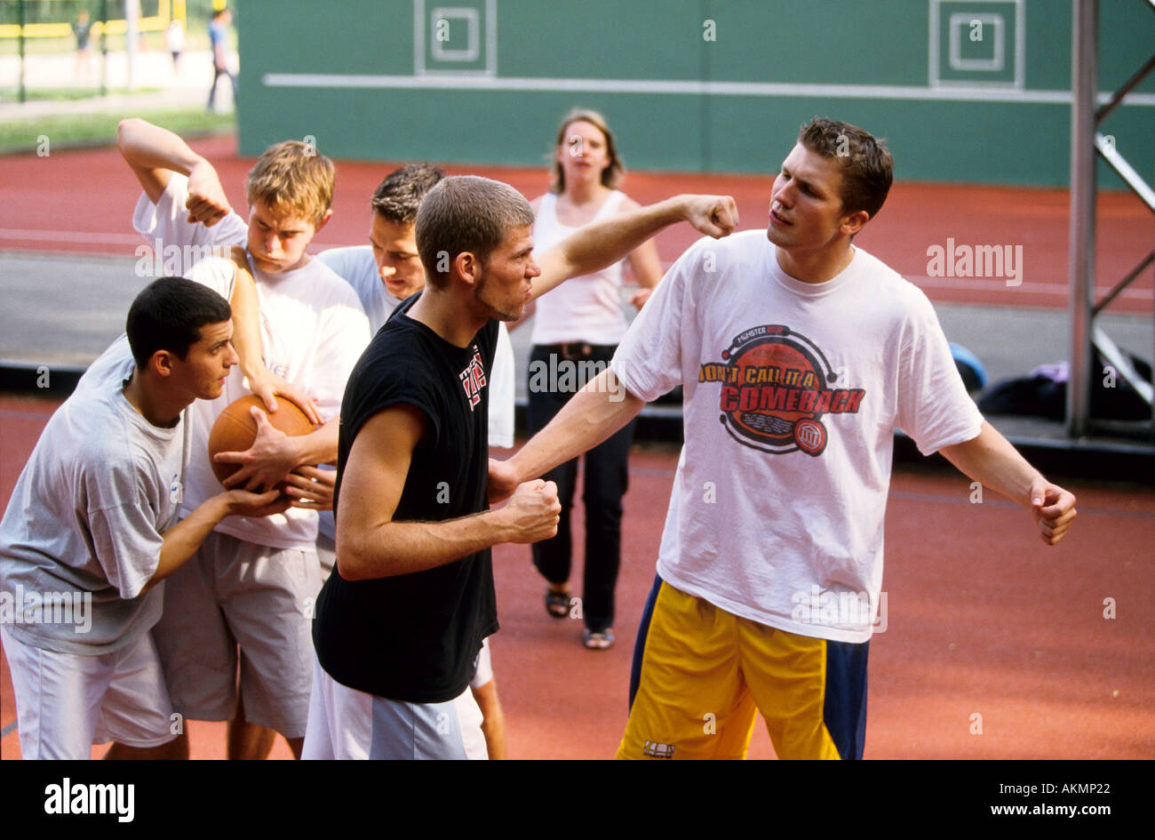 Germany Free time Young men playing basketball confrontation  - Stock Image