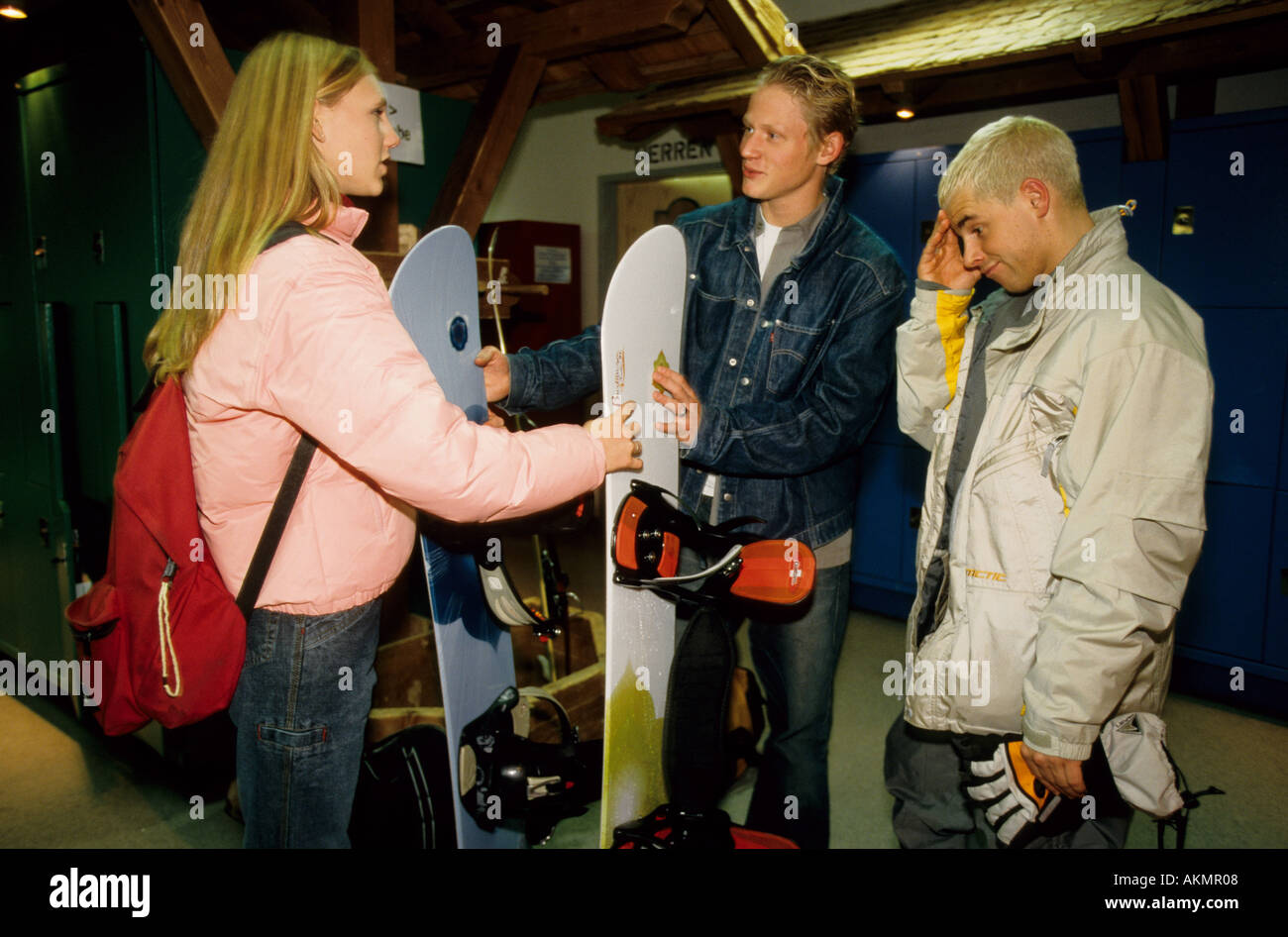 Germany Free time Young persons snowboarding they are talking to each other  - Stock Image