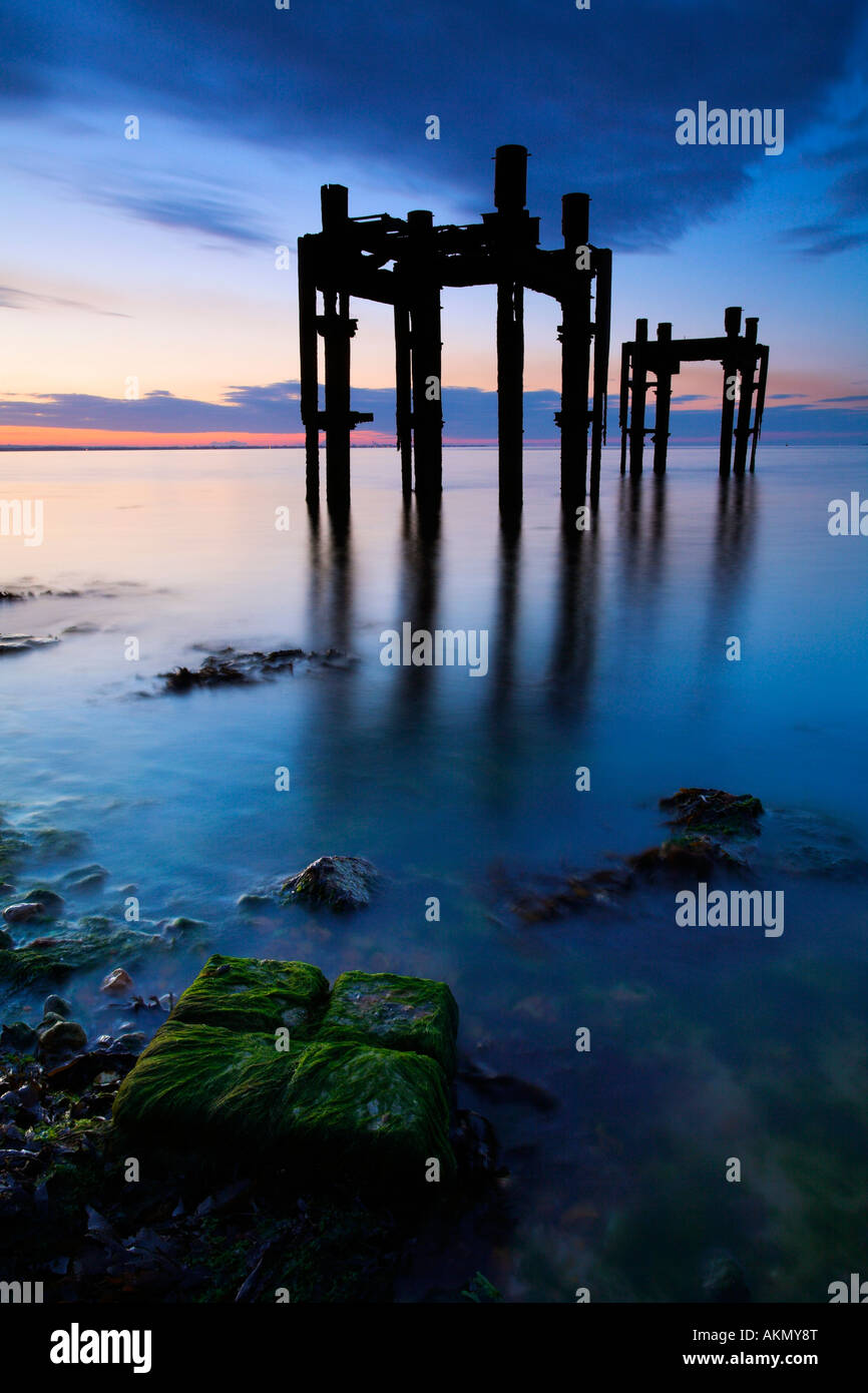 Remains of a D-Day embarkation pier at Lepe Beach, New Forest National Park, Dorset - Stock Image
