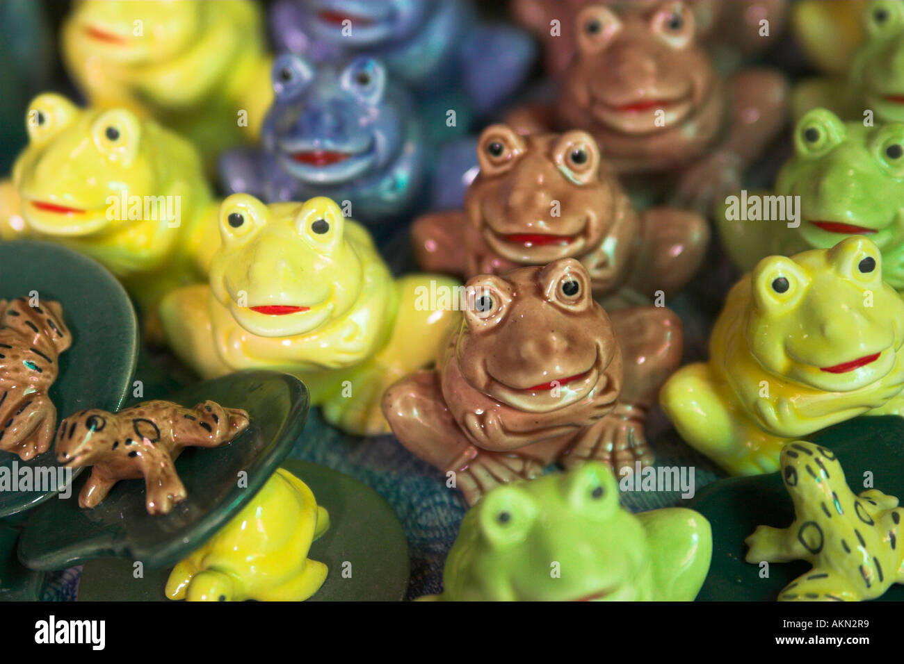 Colorful ceramic frogs sold at Kret island, Nonthaburi Thailand - Stock Image