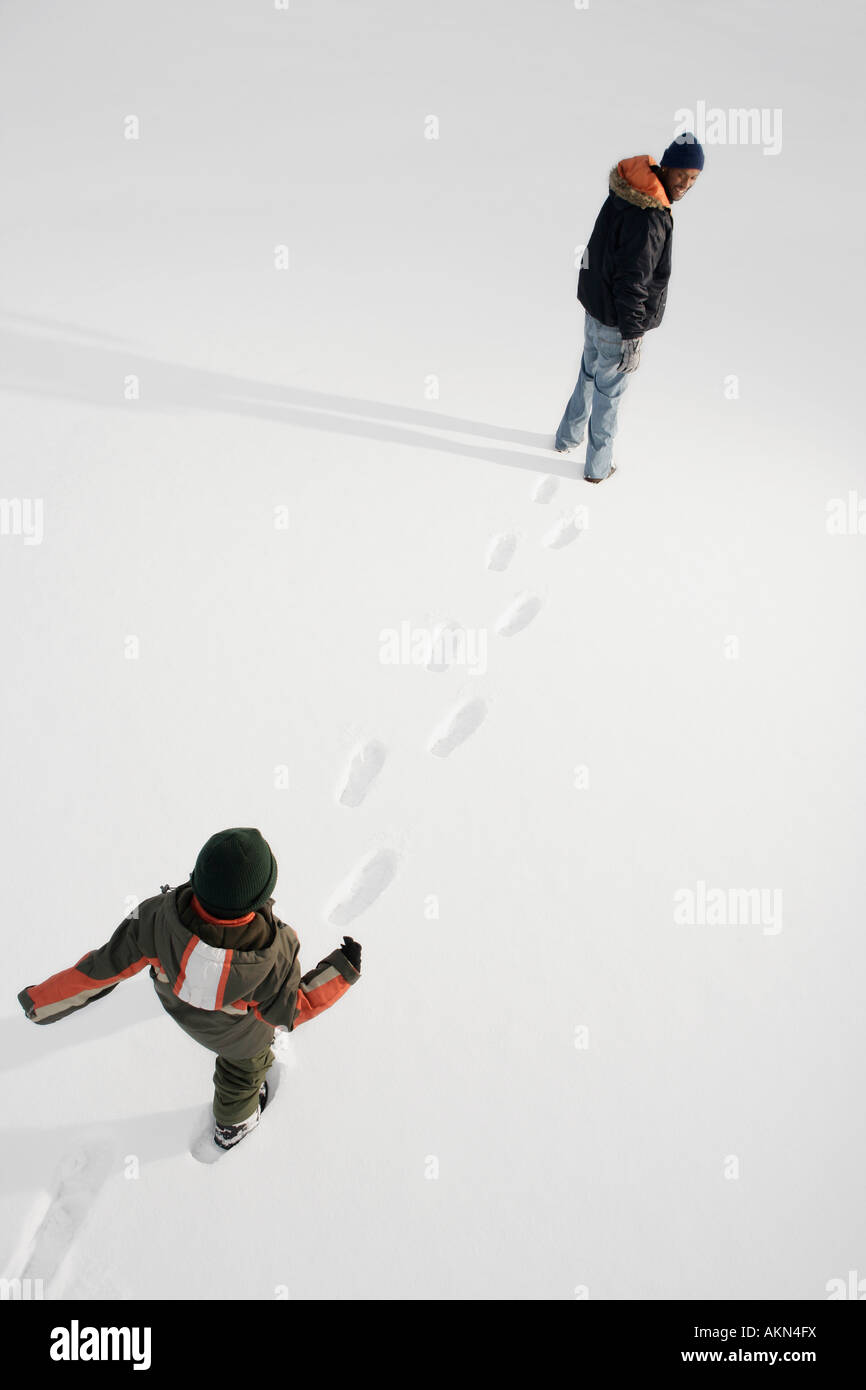 High angle view of people walking on snow - Stock Image