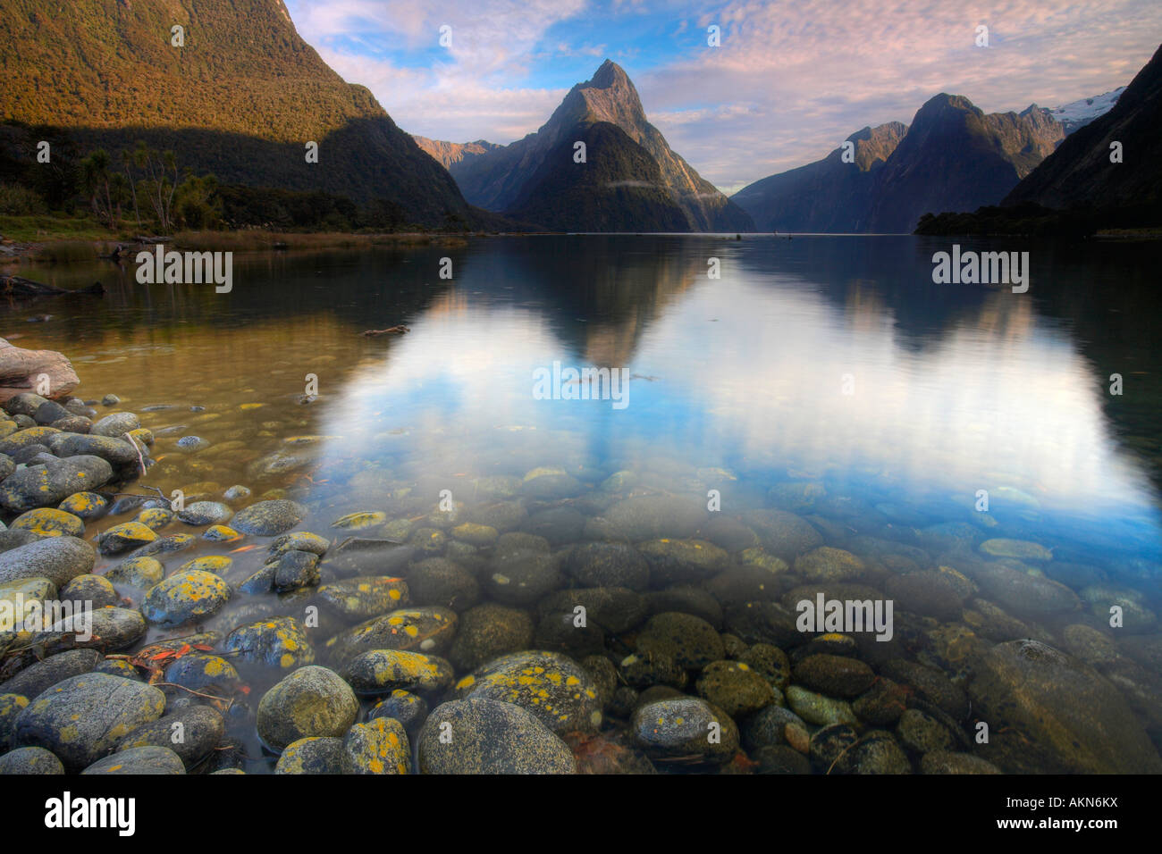 Mitre Peak rising out of the deep waters of Milford Sound, New Zealand - Stock Image