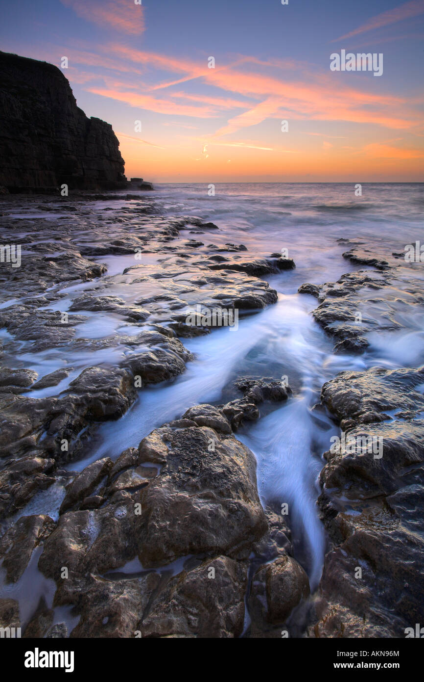 Sunrise on the rocky ledges of Seacombe on the Isle of Purbeck, Dorset - Stock Image