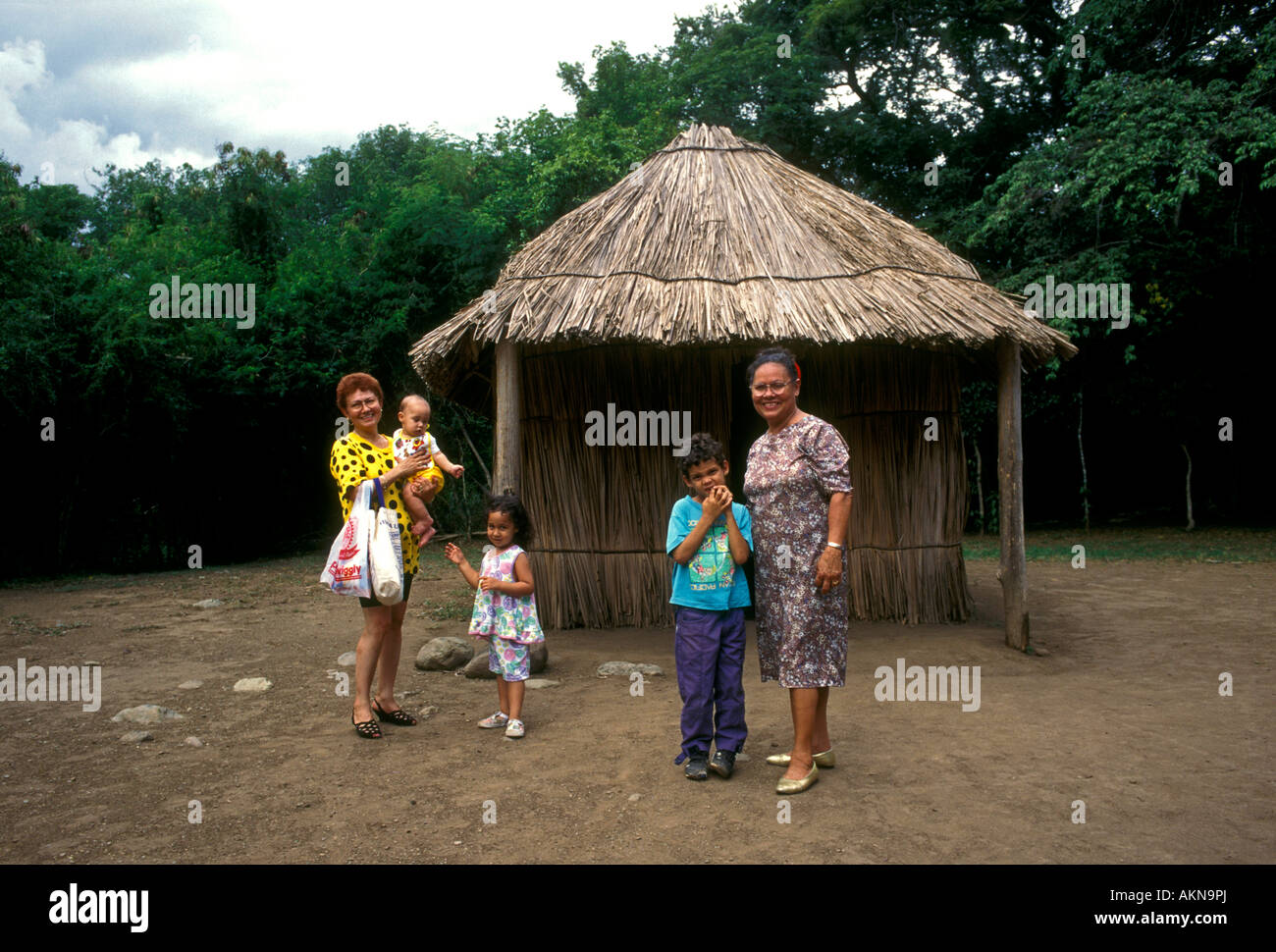 Puerto Ricans, Puerto Rican family, mother and children, tourists, visitors, visiting, Tibes Indigenous Ceremonial - Stock Image