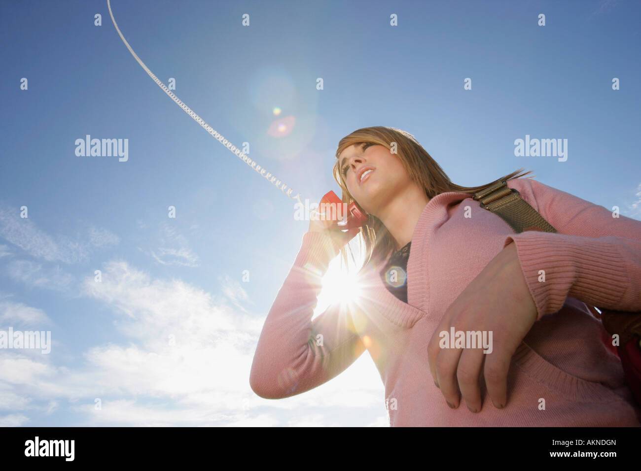Low angle view of a woman talking on phone - Stock Image