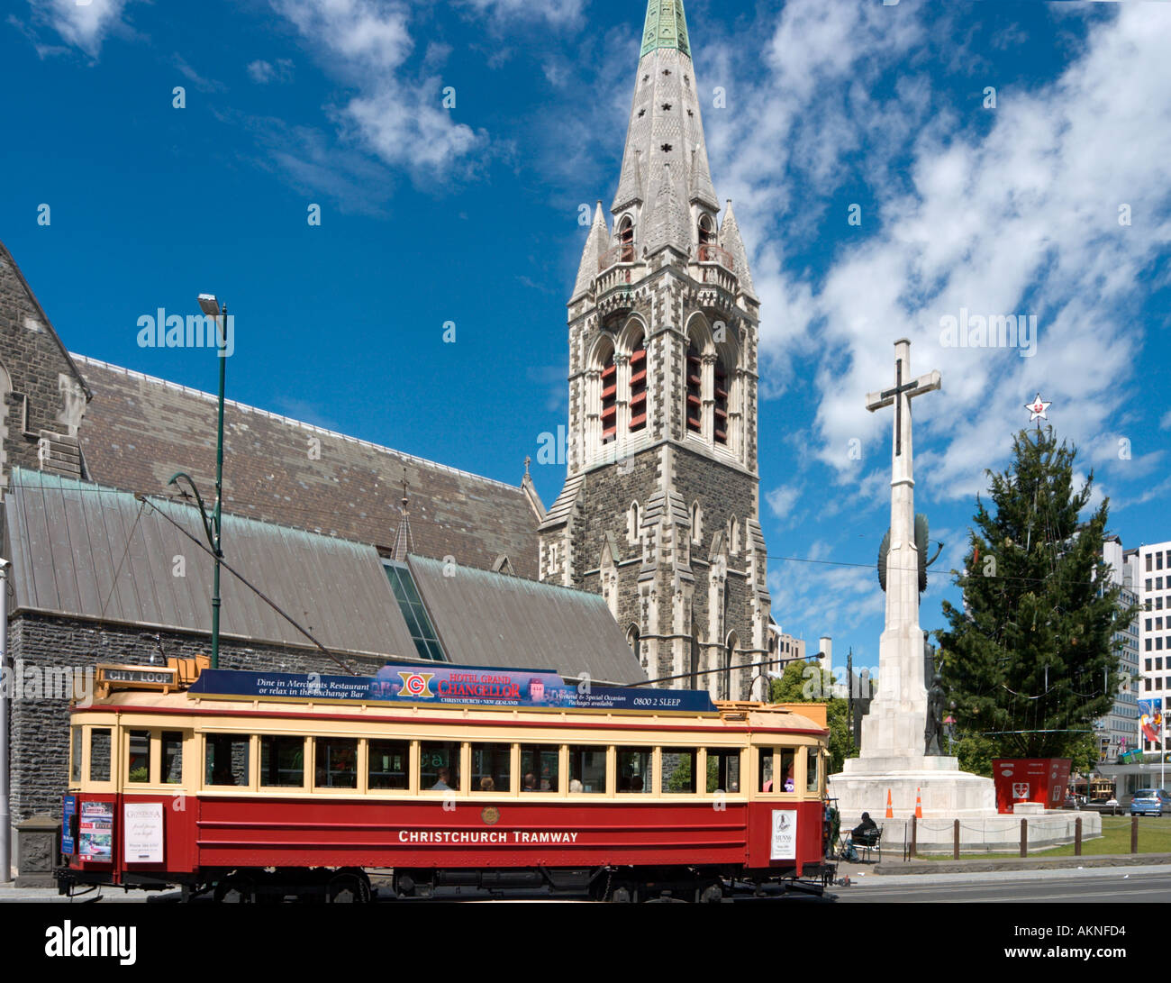 Traditional tram in front of Christchurch Cathedral, Christchurch, South Island, New Zealand - Stock Image