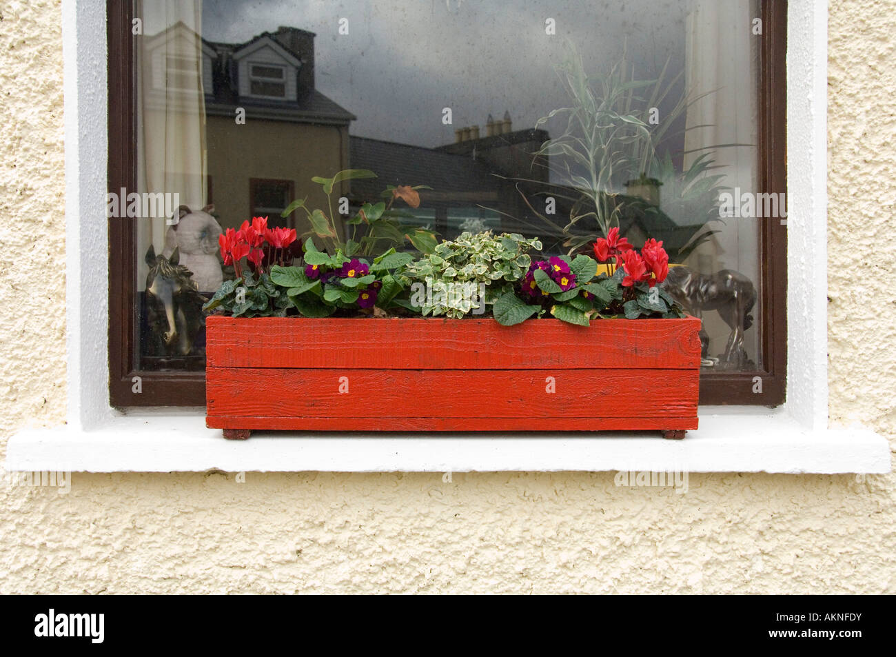 A Home Made Window Box Of Flowers In The Village Of Roundstone Stock