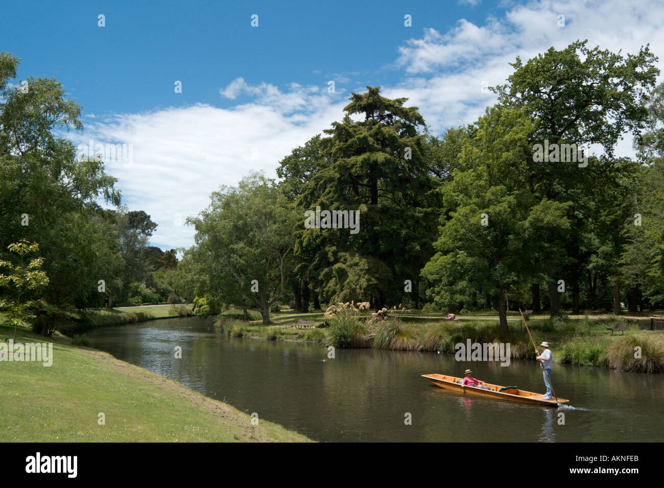 Couple punting on the Avon River in the Botanic Gardens, Christchurch, South Island, New Zealand - Stock Image
