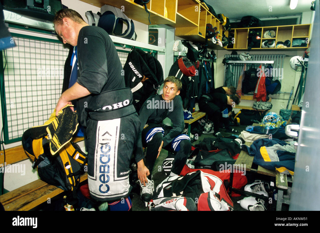 Germany Free time Young men after playing ice hockey in the cubicle  - Stock Image