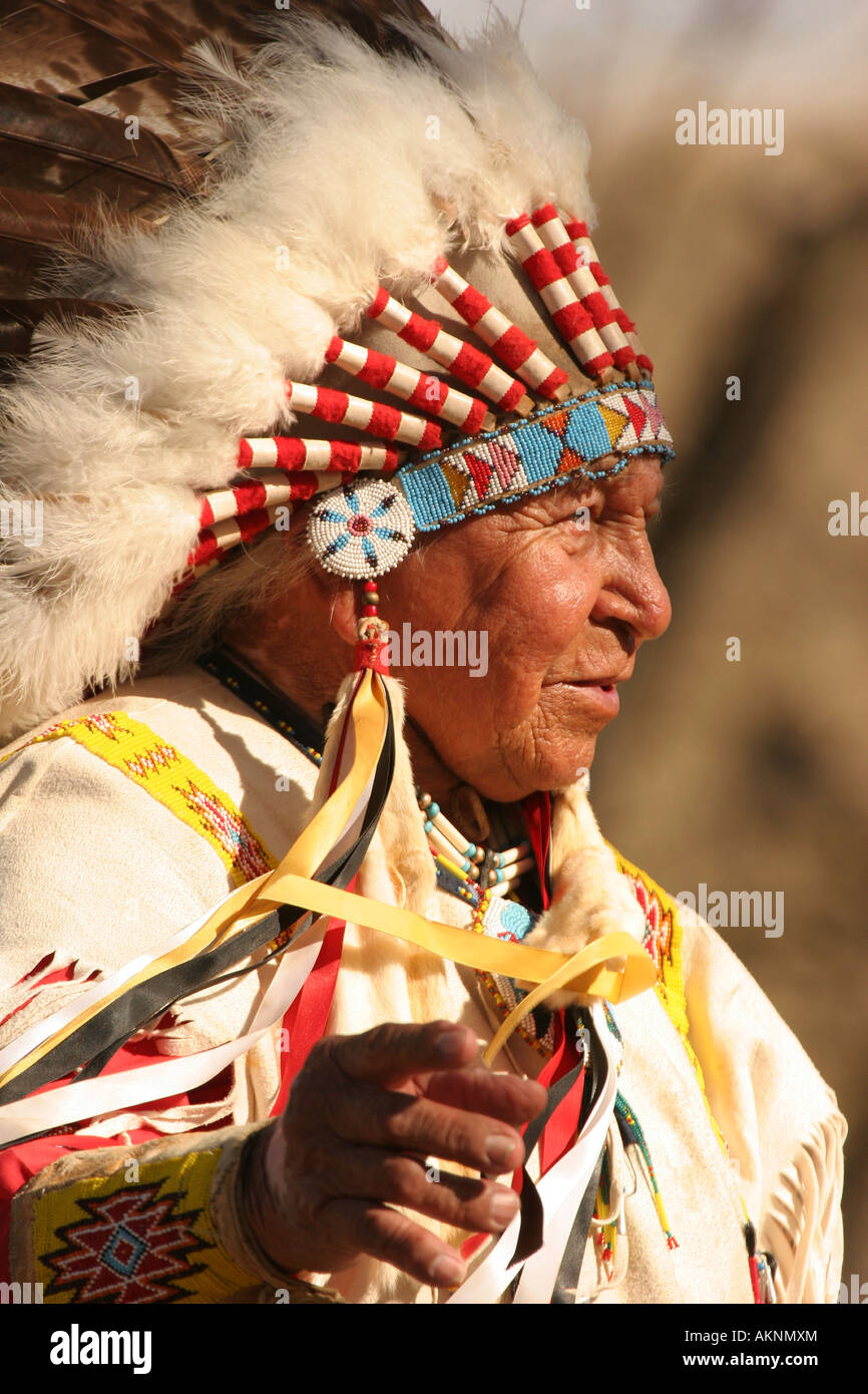 A Native American Sioux Indian telling a story outside in Fall - Stock Image