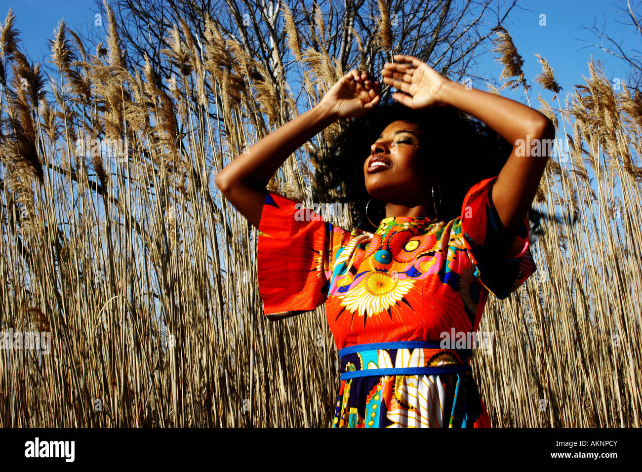 Pretty young woman face to the sky eyes closed - Stock Image