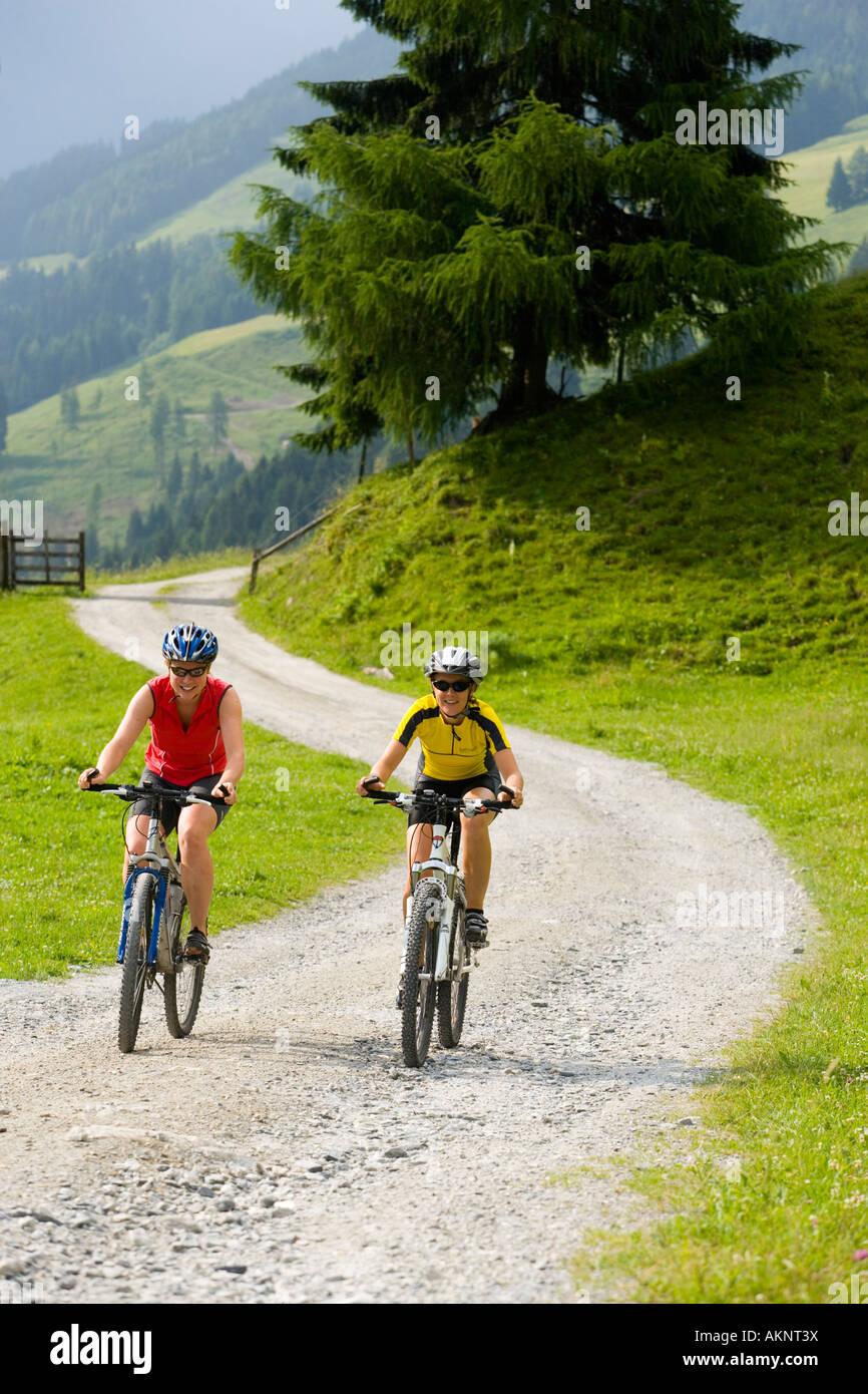 Two cyclists on the way to Amoseralm Dorfgastein Gastein Valley Salzburg Austria - Stock Image