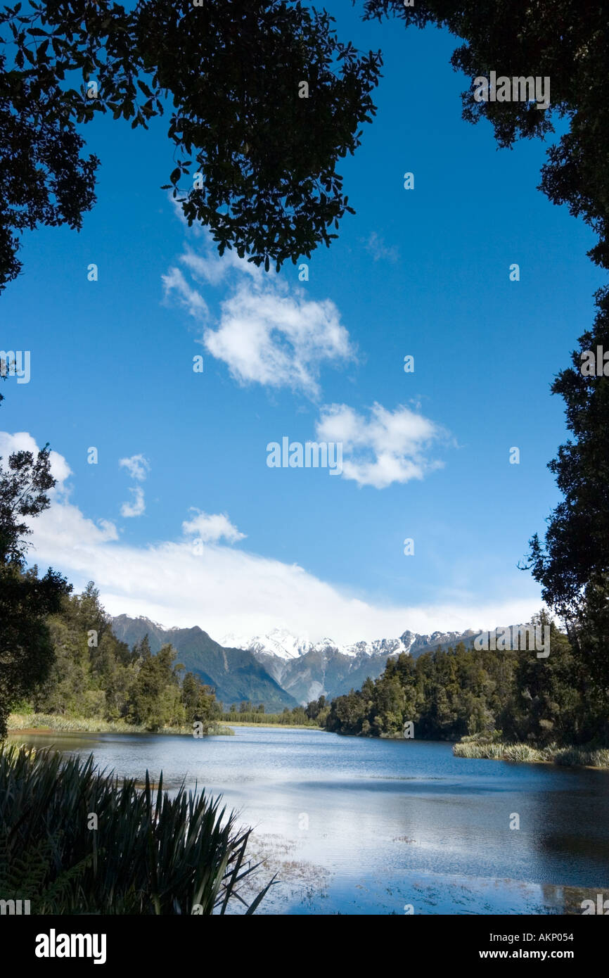 View towards Mount Cook and Mount Tasman, Lake Matheson, near Fox Glacier, South Island, New Zealand - Stock Image
