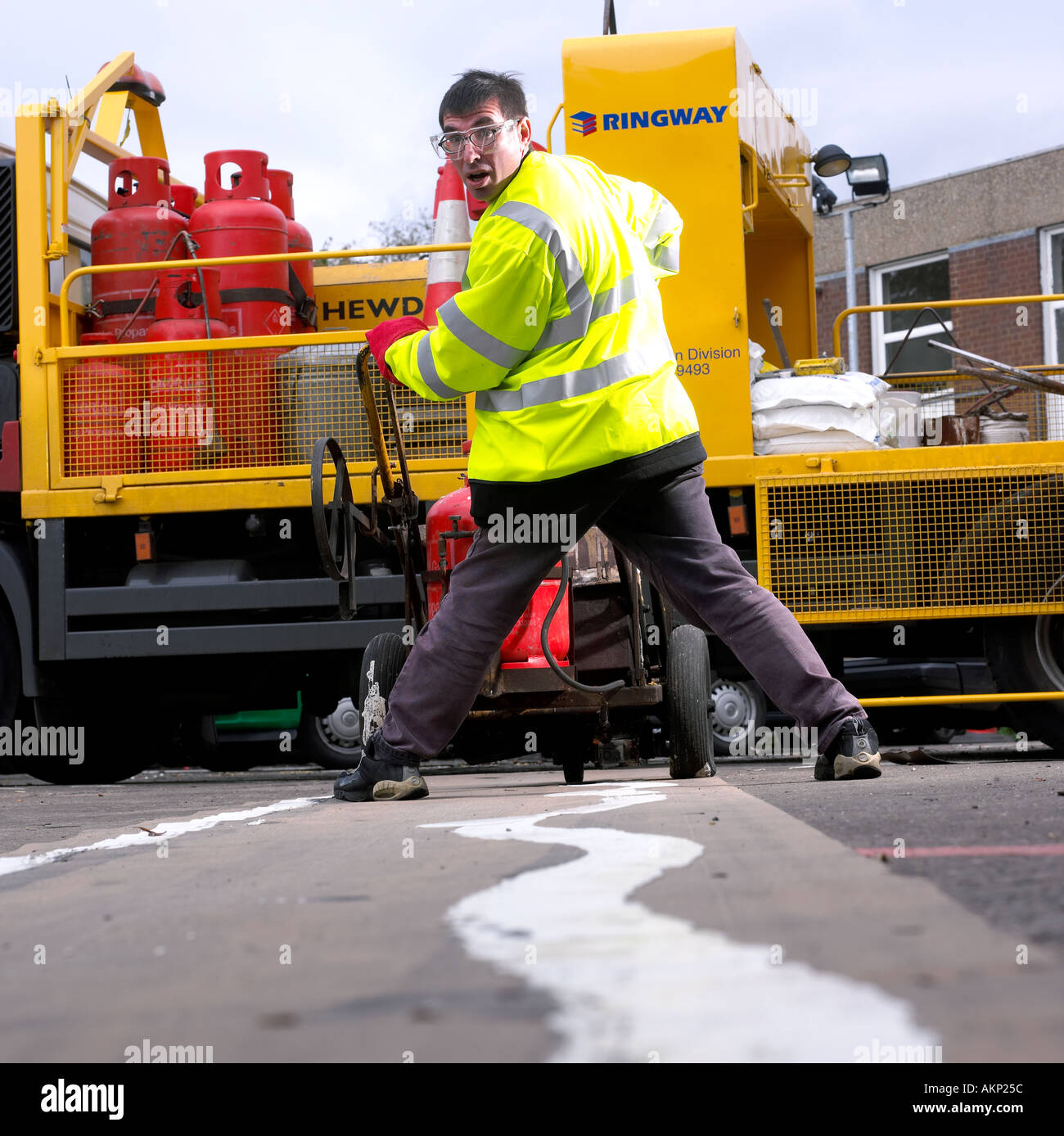 Road sign painting done badly - Stock Image