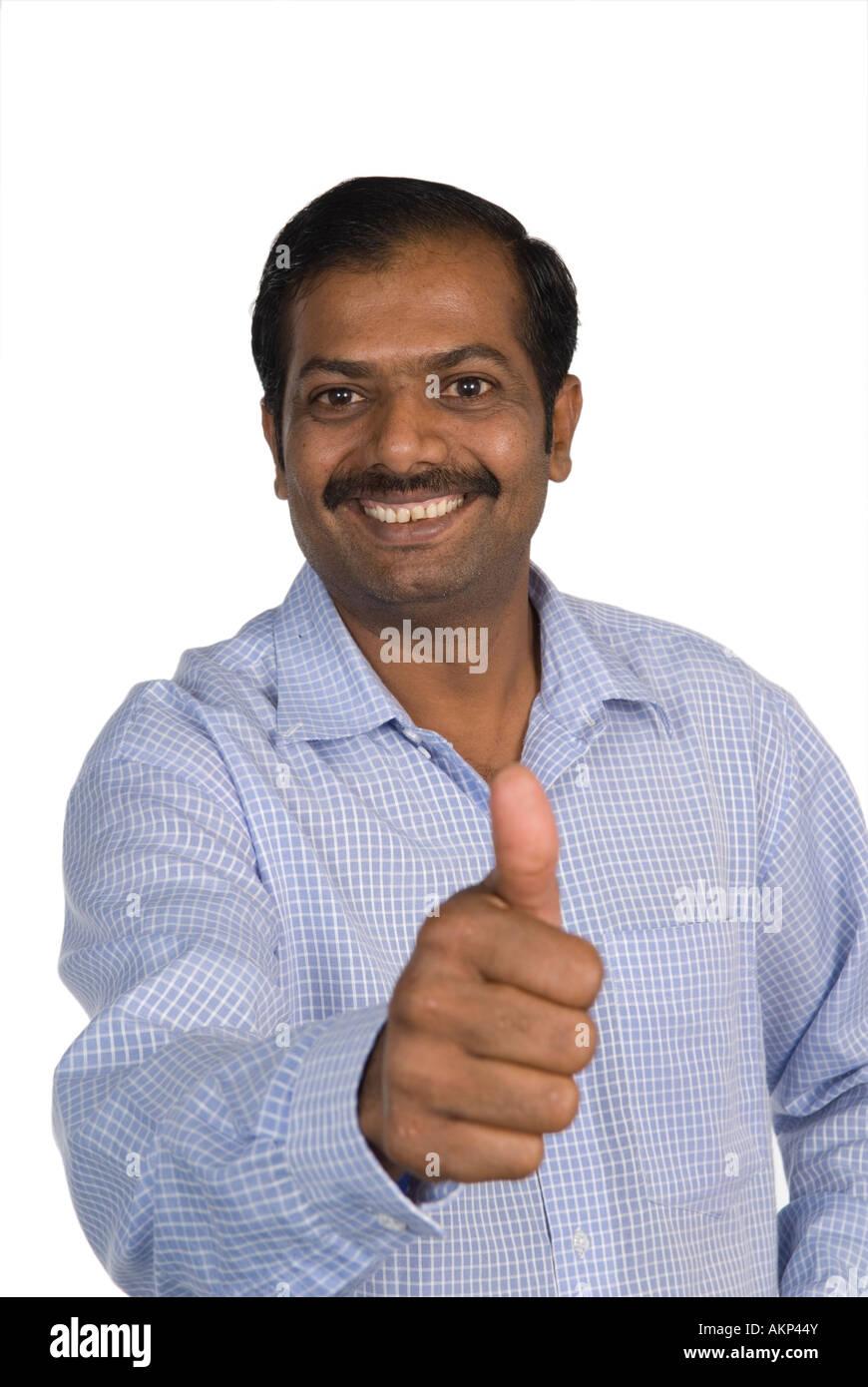mature indian man thumbs up stock photo: 15047930 - alamy