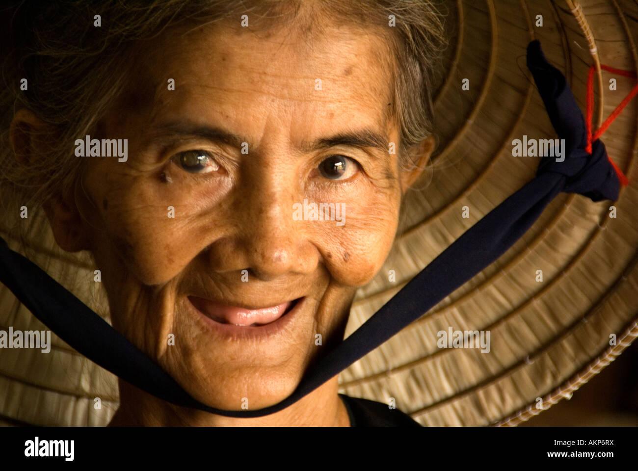 Elderly Vietnamese woman in Mekong River Delta - Stock Image
