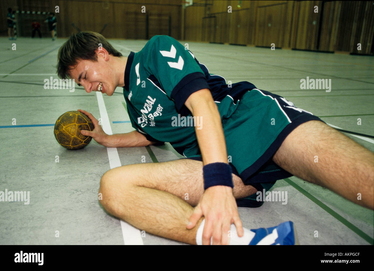 Germany Free time Handball player he is injured and lieing on the floor  - Stock Image