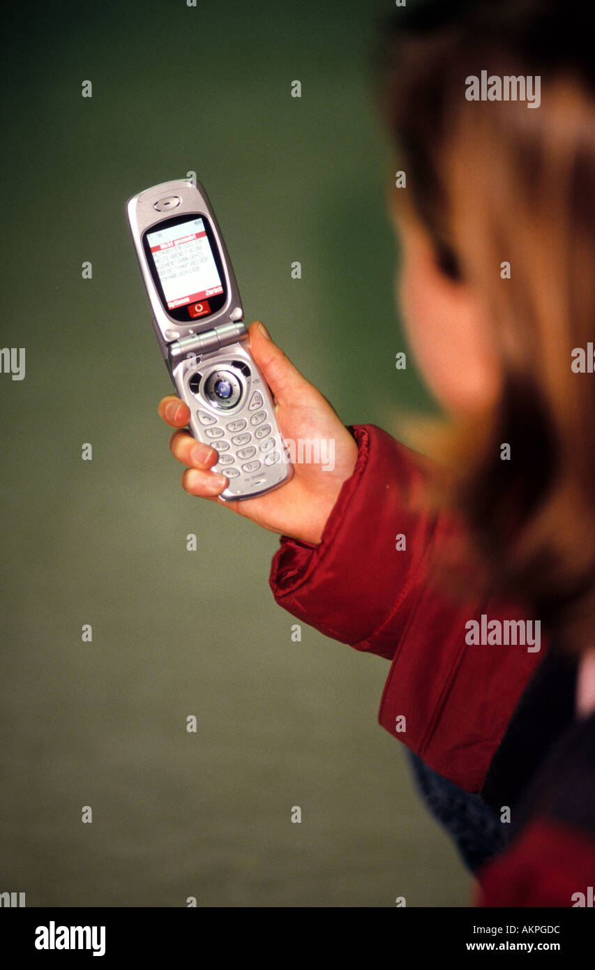 Germany Free time A young woman with a mobile phone in her hand  - Stock Image