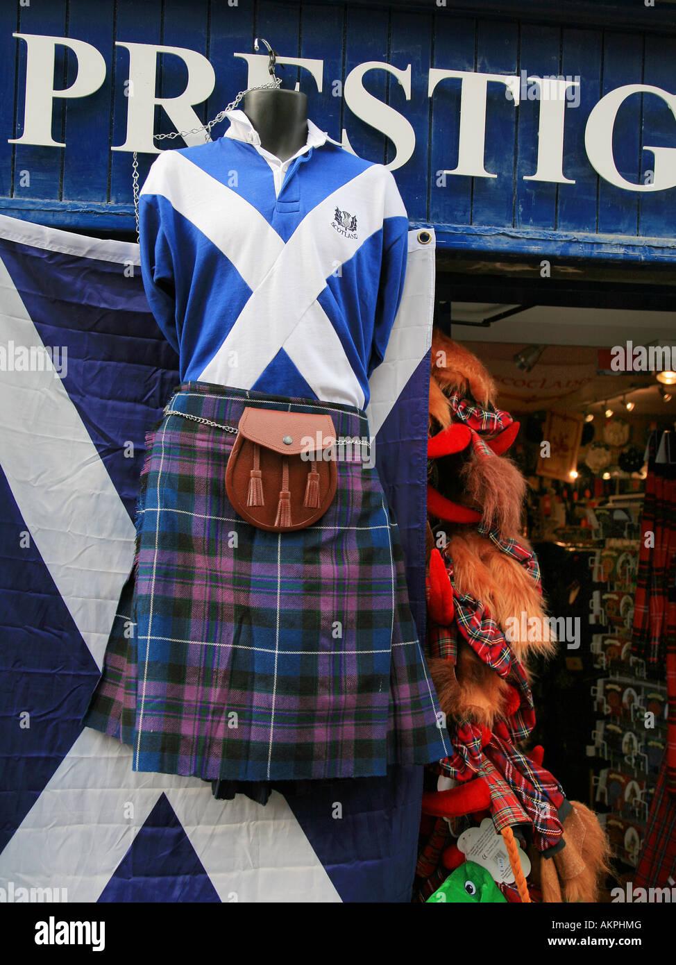 A kilt hangs outside a shop on the Royal Mile Edinburgh Scotland - Stock Image