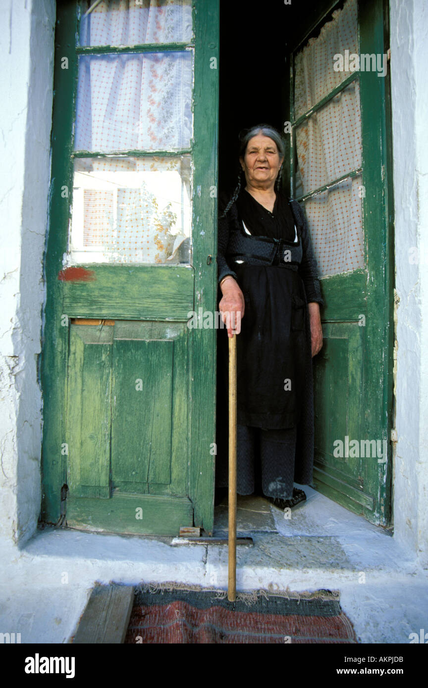 Santorini old widow in traditional black dress - Stock Image