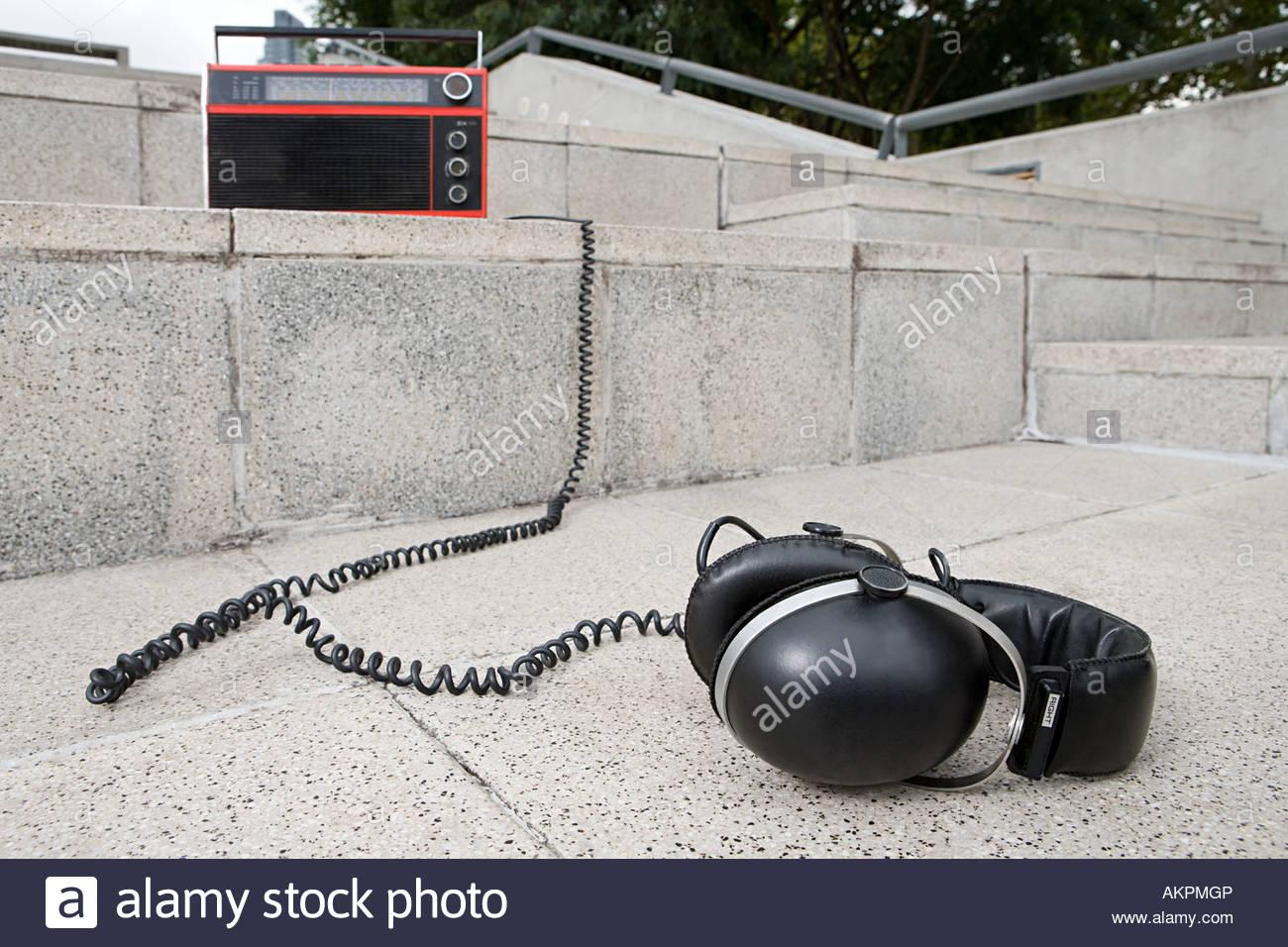 Headphones and radio on concrete steps - Stock Image