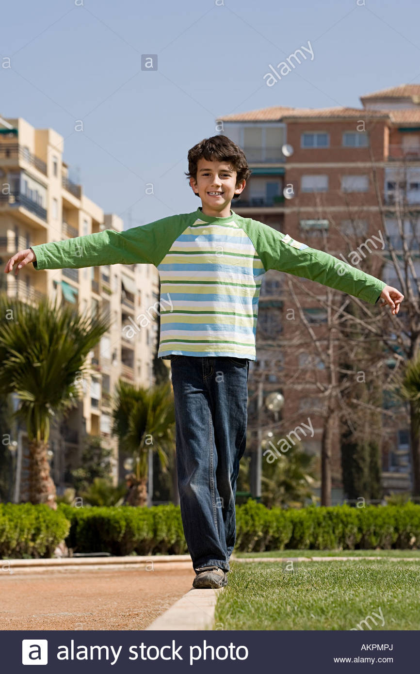Boy with arms open - Stock Image