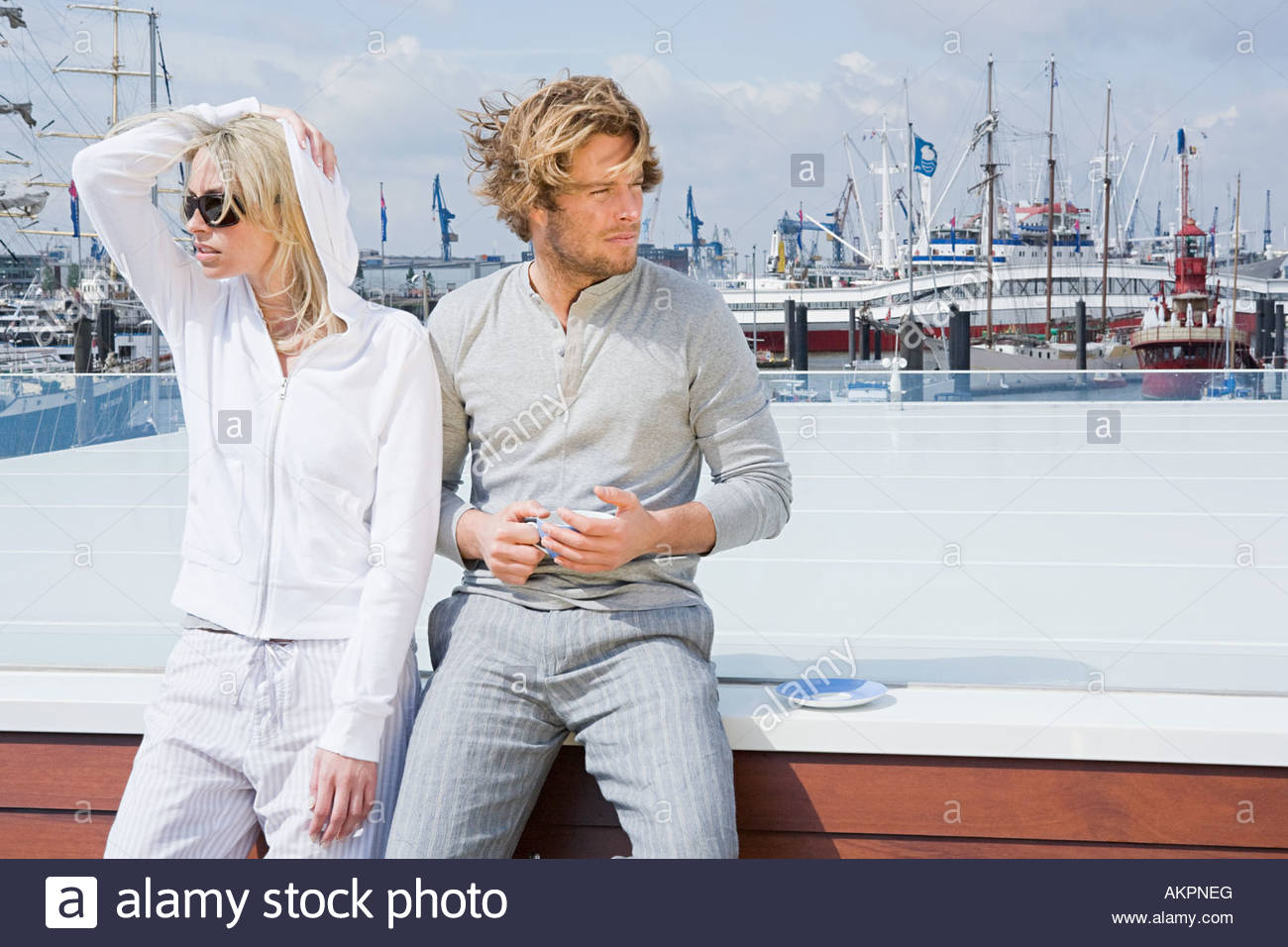 Couple at harbour - Stock Image
